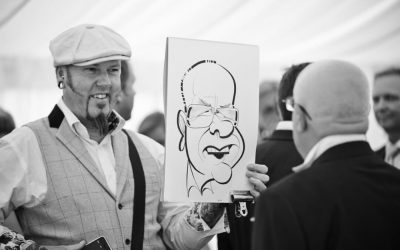 Our caricaturist creates amazing souvenirs as he mingles with duests during the drinks reception